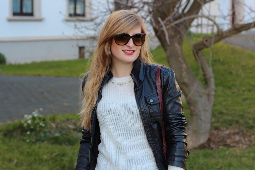 Weißer Wollpullover und Cat-Eye Sonnenbrille