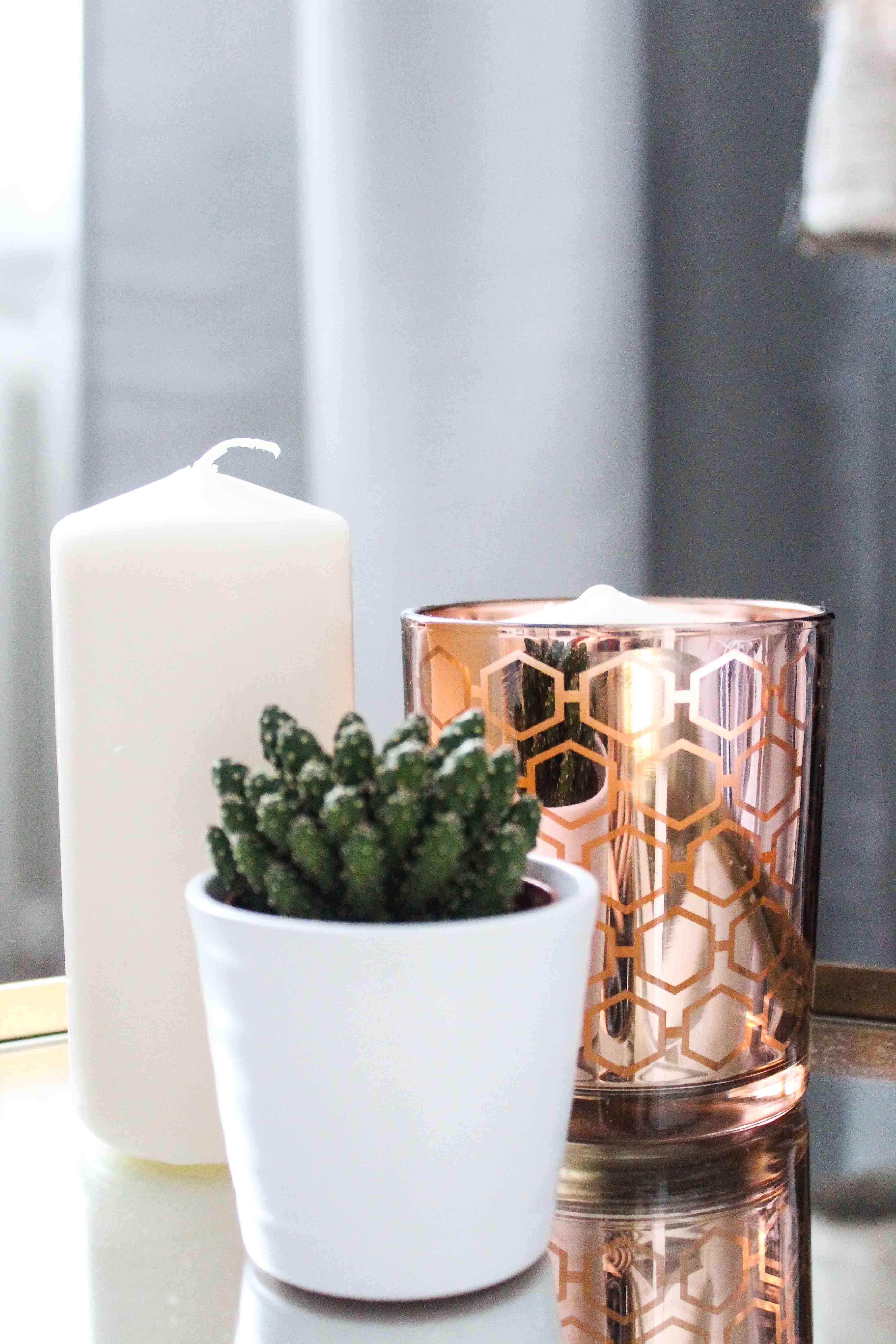 Wohntrend Kupfer Bronze Interior Shopping Dekoration Kupfer weiße Kerze Kaktus